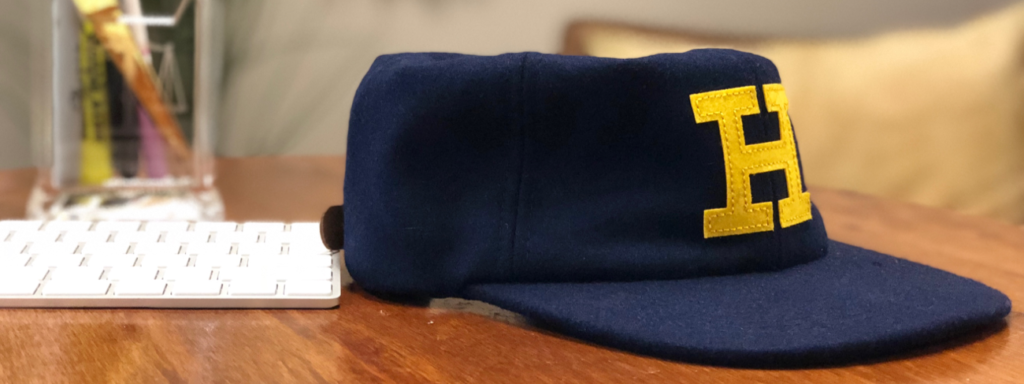 a UC hastings hat resting on a desk