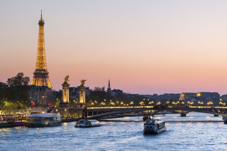 Paris, traffic on the Seine river at sunset, with Eiffel tower in background
