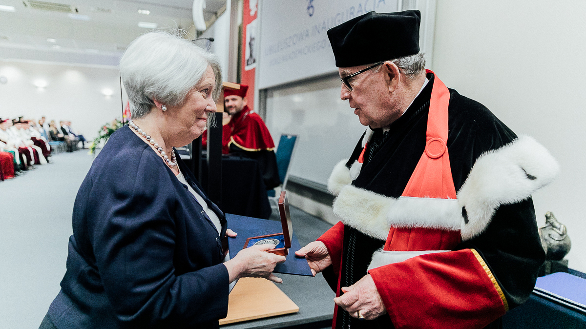 Mary Kay Kane being presented with a medal of honor from the Kozminski University in Warsaw, Poland.