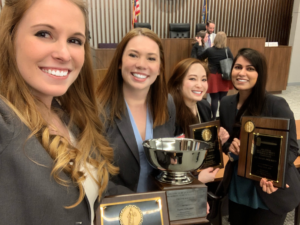 Moot Court contestants pose with trophies
